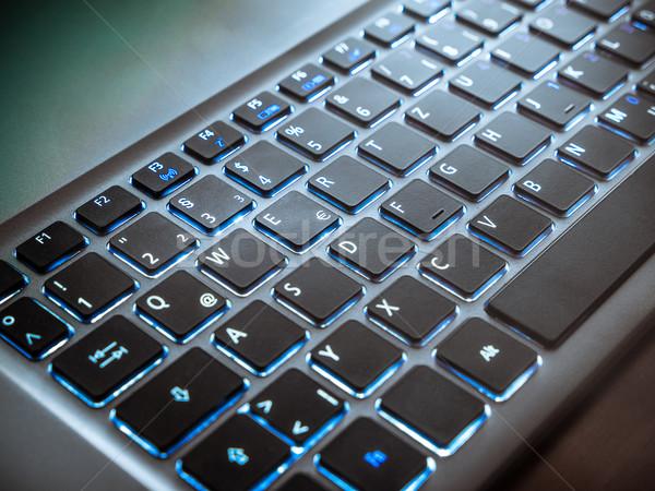 Teclado cuaderno ordenador azul negro luces Foto stock © mobi68