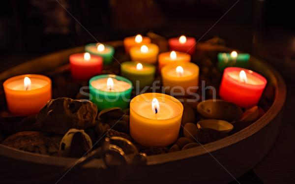 Színes gyertya fények sötét születésnap láng Stock fotó © mobi68
