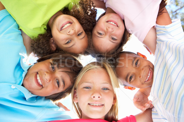 Group Of Children Looking Down Into Camera Stock photo © monkey_business