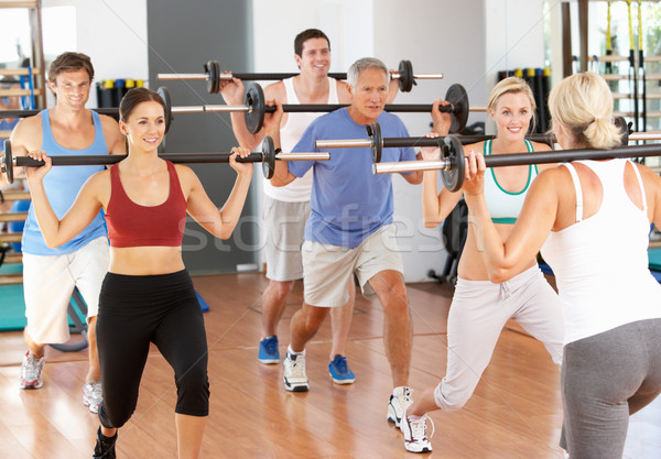 Group Of People Lifting Weights In Gym Stock photo © monkey_business
