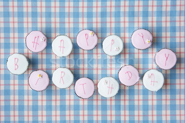 Cupcakes spell out happy birthday Stock photo © monkey_business