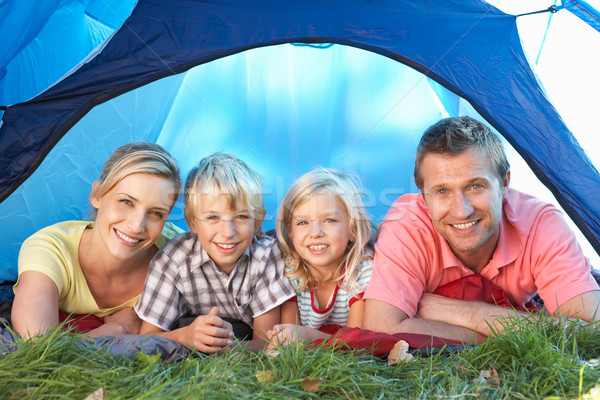 Young family poses in tent Stock photo © monkey_business