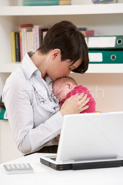 Woman With Newborn Baby Working From Home Using Laptop Stock photo © monkey_business