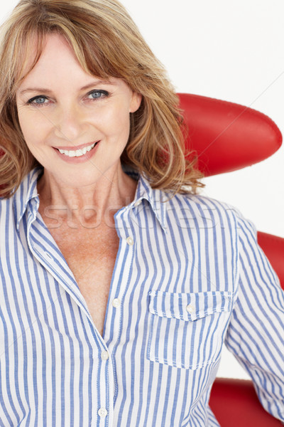 Mid age businesswoman relaxing in chair Stock photo © monkey_business