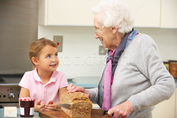 Grandmother and granddaughter preparing food in kitchen Stock photo © monkey_business