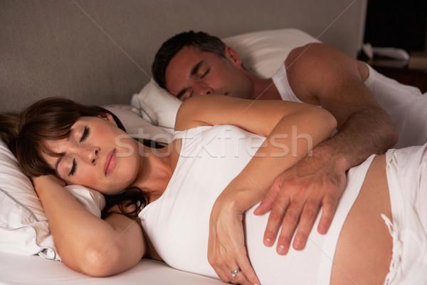 беременная женщина муж кровать женщину ребенка пару Сток-фото © monkey_business