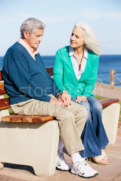 Senior Woman Comforting Depressed Husband Sitting On Bench Stock photo © monkey_business