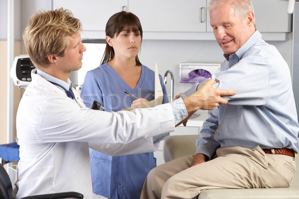 Doctor Examining Male Patient With Elbow Pain Stock photo © monkey_business