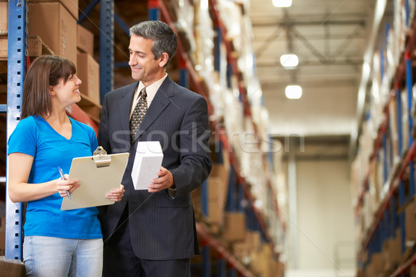 Businessman And Female Worker In Distribution Warehouse Stock photo © monkey_business