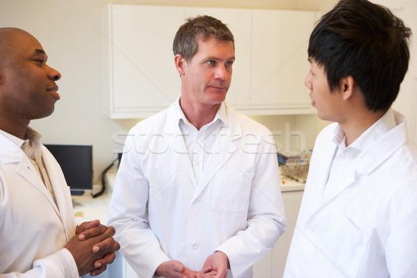 Tres médicos debate americano hospital médico Foto stock © monkey_business