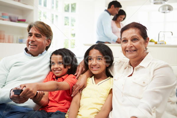 Multi-Generation Indian Family Sitting On Sofa Watching TV Stock photo © monkey_business