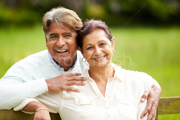 Senior Indian Couple Walking In Countryside Stock photo © monkey_business