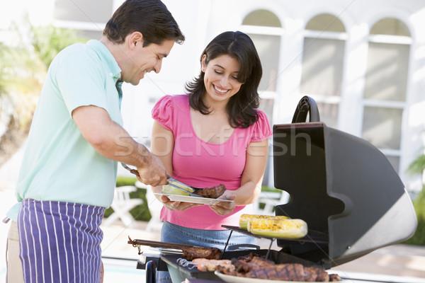 Casal cozinhar churrasco feliz jardim cor Foto stock © monkey_business