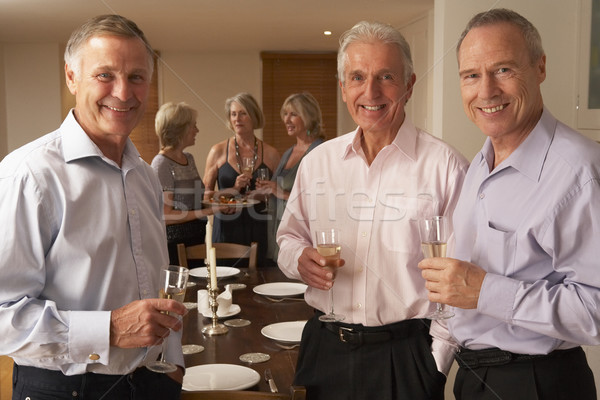 Friends Enjoying A Glass Of Champagne At A Dinner Party Stock photo © monkey_business