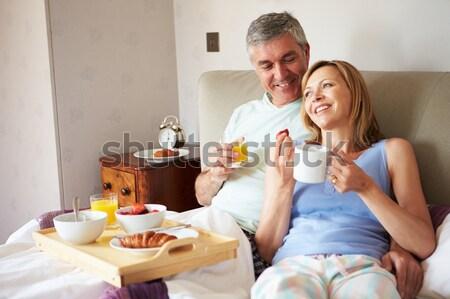 Flörtölő pár élvezi reggeli otthon barátok Stock fotó © monkey_business