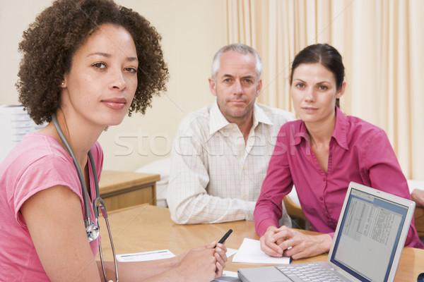 Orvos laptop pár orvosi rendelő férfi boldog Stock fotó © monkey_business