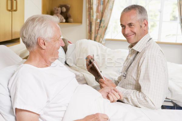Doctor Checking Up On Senior Man Stock photo © monkey_business