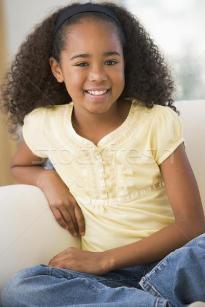 Giovane ragazza seduta divano home televisione bambino Foto d'archivio © monkey_business