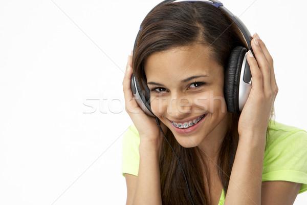 Photo stock: Portrait · souriant · adolescente · écouter · de · la · musique · femme · fille