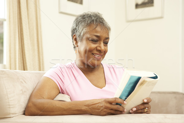 Senior Woman Reading Book At Home Stock photo © monkey_business