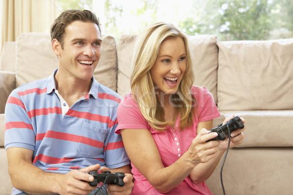 Gry gra komputerowa sofa domu człowiek Zdjęcia stock © monkey_business