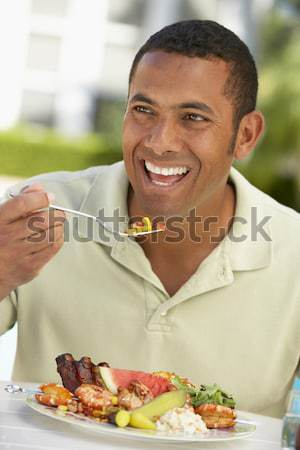 Young Man Eating Bowl Of Healthy Breakfast Cereal In Studio Stock photo © monkey_business