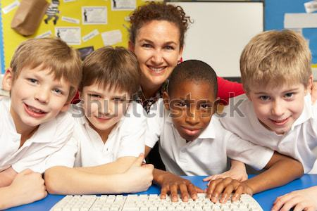 Feminino professor escola primária ensino crianças tempo Foto stock © monkey_business