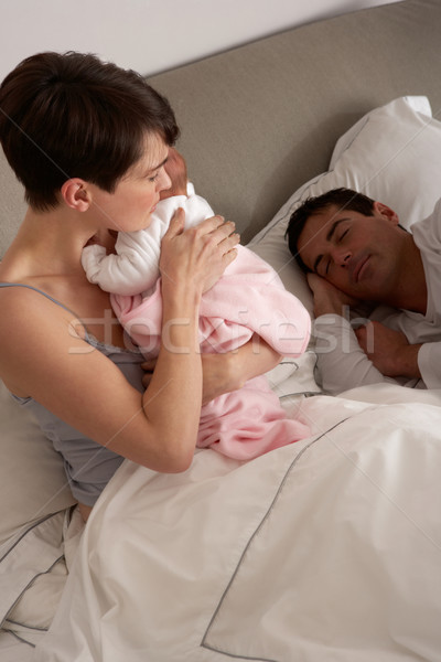 Mother Cuddling Newborn Baby In Bed At Home Stock photo © monkey_business