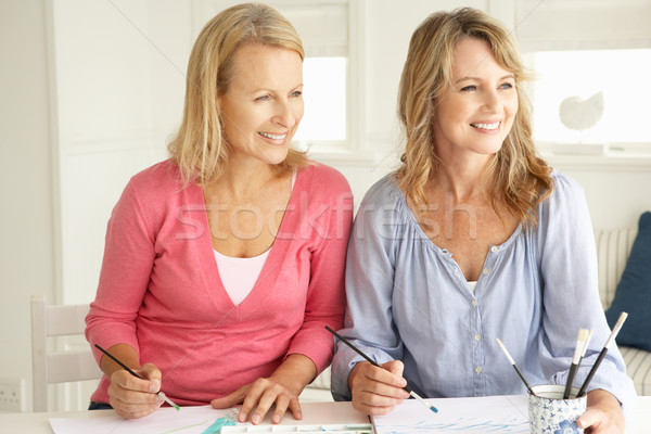 Stock photo: Mid age women painting with watercolors