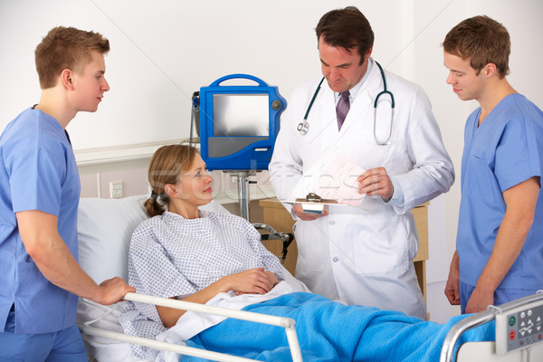 American medical team by patient's bed Stock photo © monkey_business