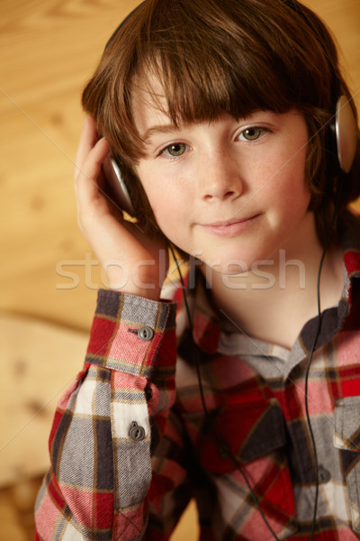 Young Boy Sitting On Wooden Seat Listening To MP3 Player Stock photo © monkey_business