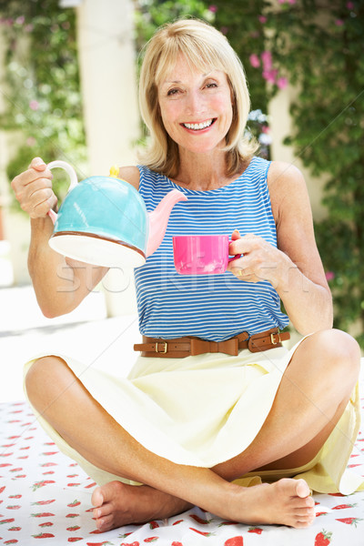 Senior Woman Pouring Cup Of Tea Stock photo © monkey_business