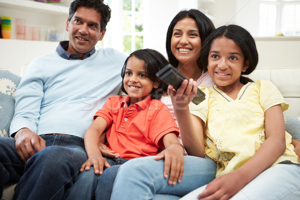 Indian Family Sitting On Sofa Watching TV Together Stock photo © monkey_business