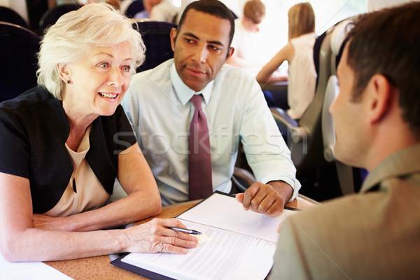 Csoport üzletemberek megbeszélés vonat nők üzletember Stock fotó © monkey_business