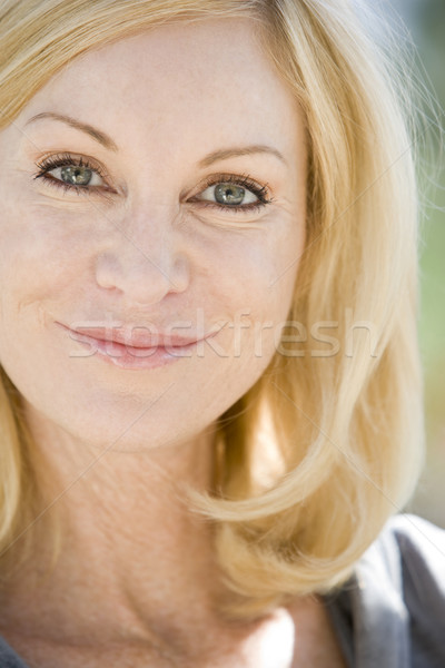 Stock photo: Head shot of woman smiling