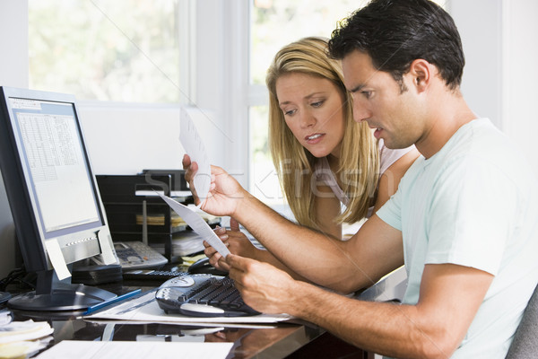 Couple in home office with computer and paperwork looking unhapp Stock photo © monkey_business