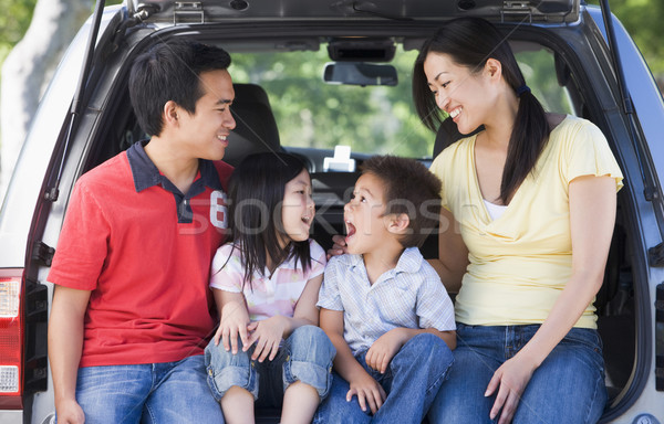 Family sitting in back of van smiling Stock photo © monkey_business