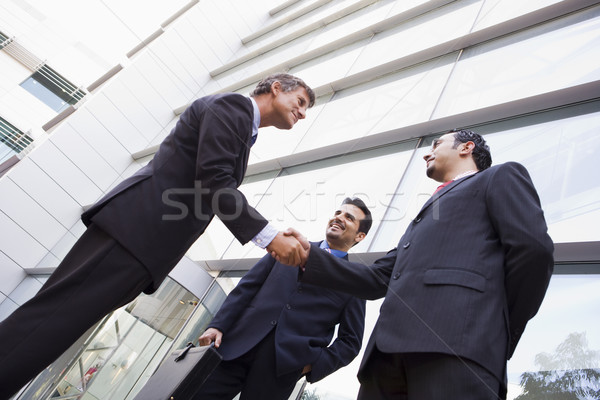 Group of businessmen shaking hands outside office Stock photo © monkey_business