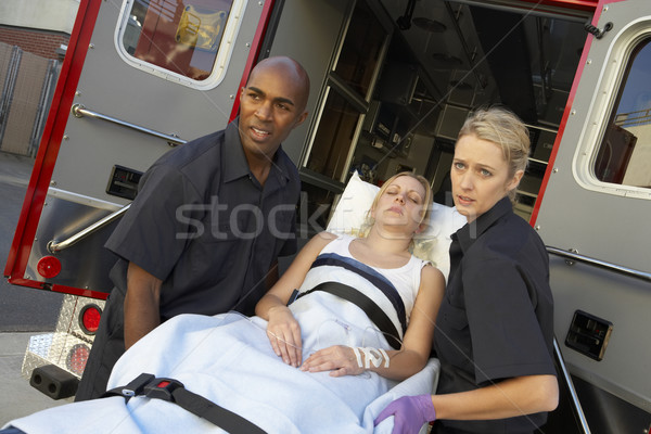 Paramedics unloading patient from ambulance Stock photo © monkey_business