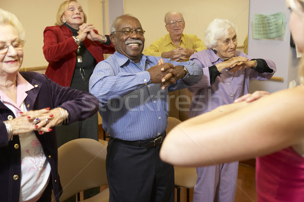 Senior adults in a stretching class Stock photo © monkey_business