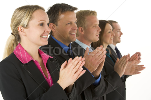 Group Of Business People In A Line Smiling And Applauding Stock photo © monkey_business