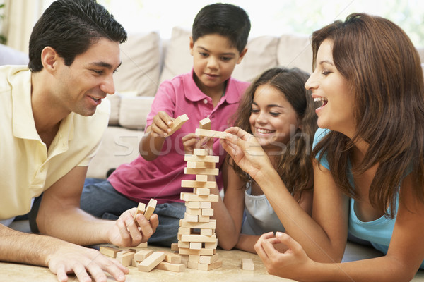 Stock photo: Family Playing Game Together At Home