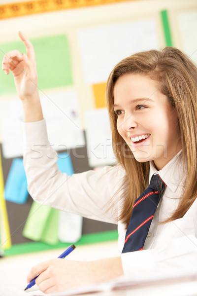 Teenage Female Student Answering Question In Classroom Stock photo © monkey_business
