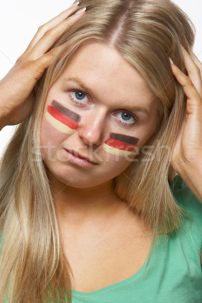 Disappointed Young Female Sports Fan With German Flag Painted On Stock photo © monkey_business