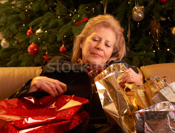 Tired Senior Woman Returning After Christmas Shopping Trip Stock photo © monkey_business