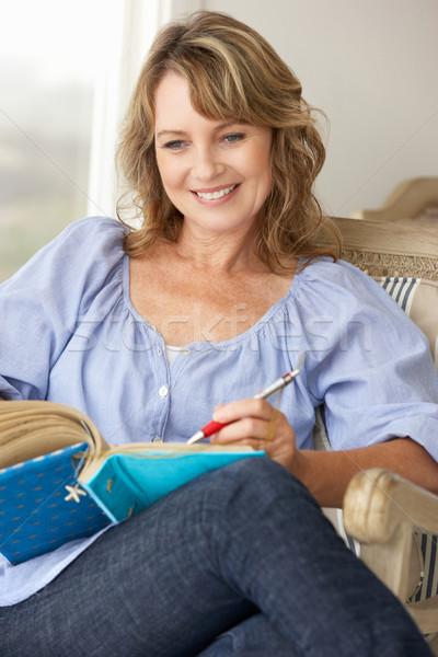 Középkorú nő ír notebook portré személy Stock fotó © monkey_business