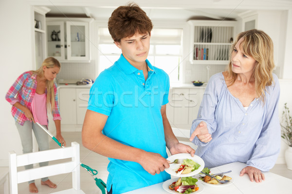 Teenagers reluctant to do housework Stock photo © monkey_business