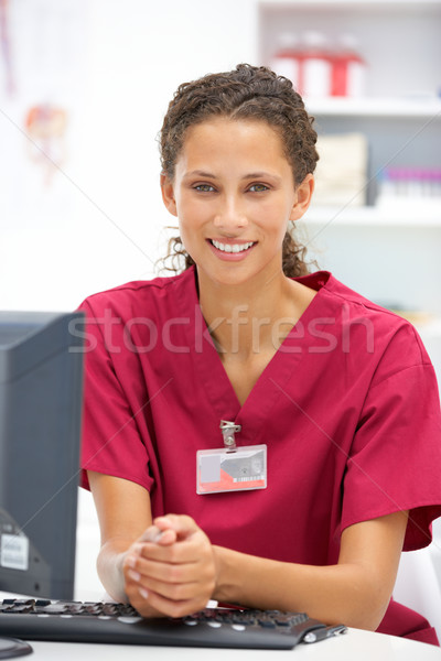 Young hospital doctor at desk Stock photo © monkey_business