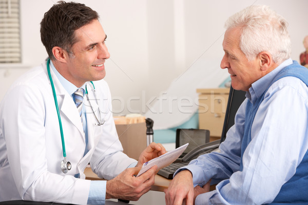American doctor talking to senior man in surgery Stock photo © monkey_business