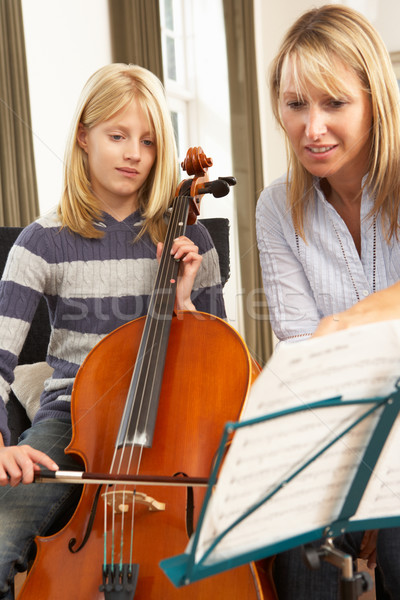 Menina jogar violoncelo música lição professor Foto stock © monkey_business